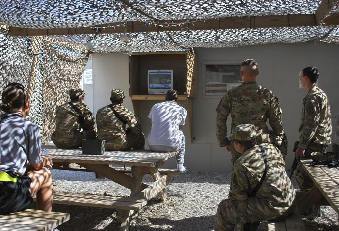 This image provided by the U.S. Army shows U.S. soldiers and service members as they watch the cable news coverage of the death of al Qaeda leader Osama bin Laden on a television at the Bagram air field on Monday. Bin Laden was slain in his hideout in Pakistan early Monday in a firefight with U.S. forces, ending a manhunt that spanned a decade. (Associated Press)