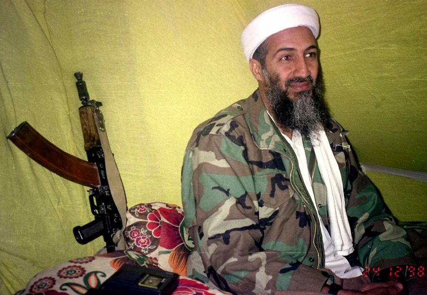** FILE ** In this Dec. 24, 1998, file photo, Muslim militant and al Qaeda leader Osama Bin Laden speaks to a selected group of reporters in mountains of Helmand province in southern Afghanistan. (AP Photo/Rahimullah Yousafzai, File)