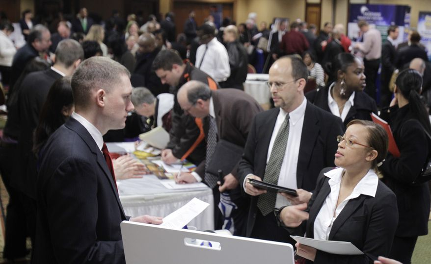 Justin Miller (left) talks with Leah Chanthapanya (right) at a May 3 job fair in Independence, Ohio. Chanthapanya is looking for a customer service or administrative position. Employers added more than 200,000 jobs in April for the third straight month, the biggest hiring spree in five years. But the unemployment rate rose to 9 percent in part because some people resumed looking for work. (Associated Press)