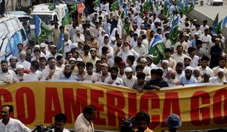 Supporters of the Pakistani religious party Jamaat-e-Islami rally Friday to condemn the killing of al Qaeda leader Osama bin Laden, in Lahore, Pakistan. Osama bin Laden was killed by a helicopter-borne U.S. military force on Monday, in a fortress-like compound on the outskirts of Pakistani city of Abbottabad. (Associated Press)