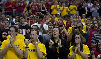 """Hundreds of University of Maryland students and alumni applaud as Coach Gary Williams enters the Comcast Center at the University of Maryland in College Park, Md., on Friday, May 6, 2011 to officially announce his retirement as the school's basketball coach. Many students sported yellow """"Garyland"""" t(...)"""
