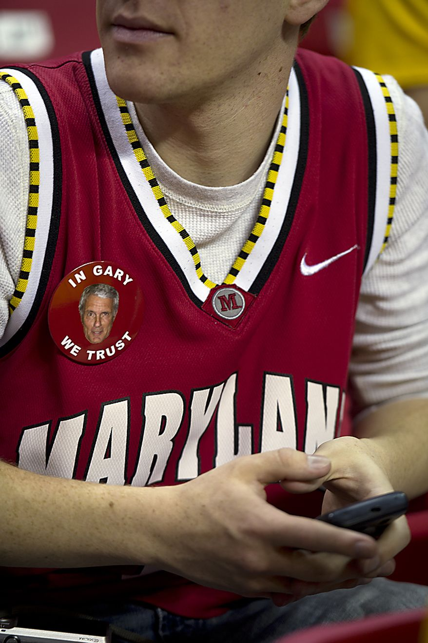 "A University of Maryland student wears his Maryland jersey and a ""In Gary We Trust"" button at a press conference Friday, May 6, 2011 at the Comcast Center in College Park, Md., where Coach Gary Williams officially announced his retirement. Williams has been coaching basketball for 30 years, the last(...)"