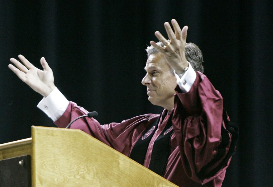 Former U.S. Ambassador to China and former Utah governor Jon Huntsman Jr. ends his address to graduates of the South Carolina Honors College and the College of Arts and Sciences Saturday, May 7, 2011, in Columbia, S.C. (AP Photo/Mary Ann Chastain)