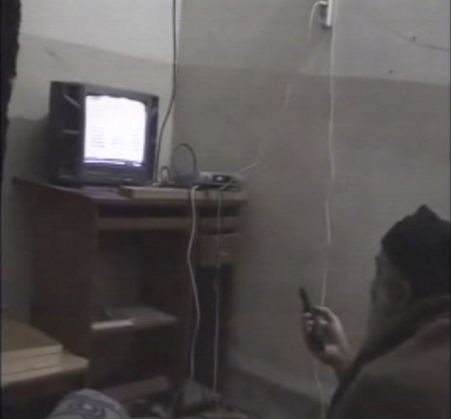 In this undated image taken from video provided by the U.S. Department of Defense, a man who the American government says is Osama bin Laden watches television in a video released on Saturday, May 7, 2011. The videos show bin Laden watching himself on television and rehearsing for terrorist videos. (AP Photo/Department of Defense)