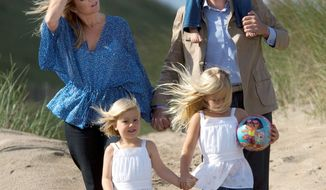 ASSOCIATED PRESS PHOTOGRAPHS Netherland's Crown Prince Willem Alexander holds Princess Ariane on his shoulders as he and his wife Princess Maxima, along with Princess Amalia (front right) and Princess Alexia (front left) visit a beach near Wassenaar, Netherlands, during the summer in 2009. Princess Maxima is so popular in the Netherlands that an exhibition at the former royal palace Het Loo has opened to mark her first 10 years in the country.