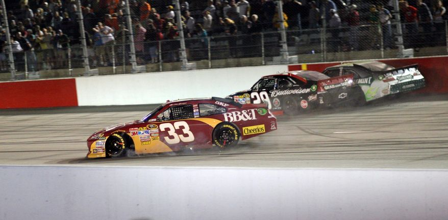 ASSOCIATED PRESS Clint Bowyer (33) spun out on the frontstretch next to Kevin Harvick (29) and Kyle Busch (near wall) during the Southern 500 on Saturday at Darlington, S.C. Harvick and Busch engaged in an altercation after the race, which was won by Regan Smith.