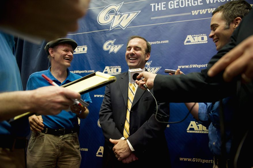 The George Washington University's incoming men's basketball Head Coach Mike Lonergan fields questions from reporters following a press conference to announce his arrival in Washington, D.C., Monday, May 9, 2011. Mr. Lonegran brings to GW 18 years as a college head coach, with an overall record of 377-156, 15 winning seasons, 13 NCAA Tournament victories including a NCAA Division III national championship. (Rod Lamkey Jr./The Washington Times)