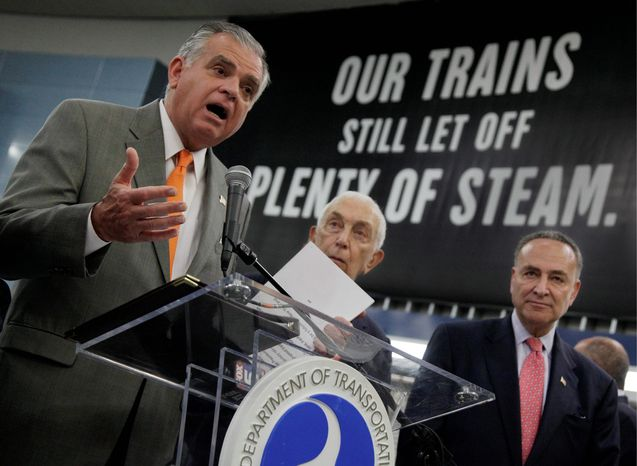 ASSOCIATED PRESS U.S. Transportation Secretary Ray LaHood (left) is joined by Democratic Sens. Frank R. Lautenberg of New Jersey and Charles E. Schumer of New York (right) at New York's Pennsylvania Station on Monday for an announcement of nearly $800 million in projects to improve service in the t