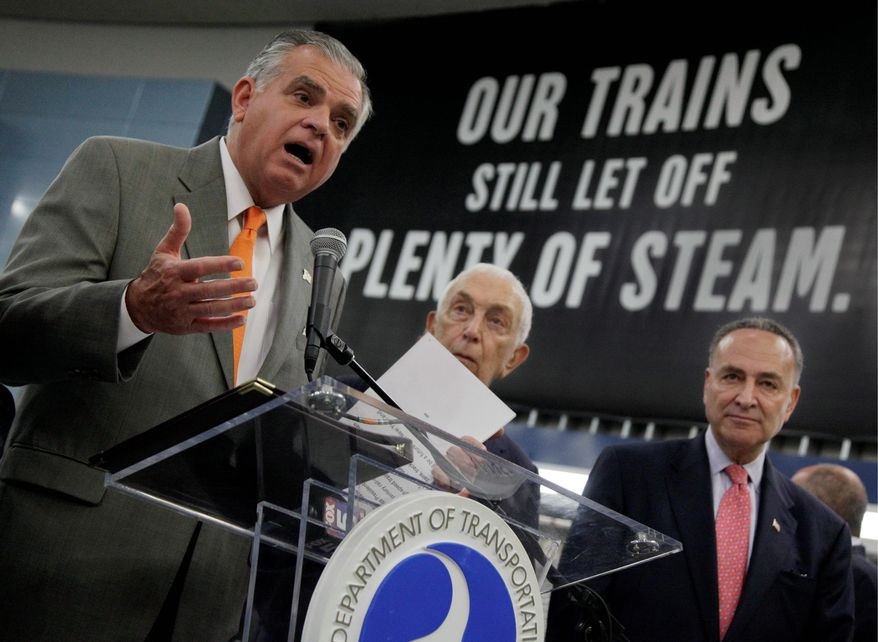 ASSOCIATED PRESS U.S. Transportation Secretary Ray LaHood (left) is joined by Democratic Sens. Frank R. Lautenberg of New Jersey and Charles E. Schumer of New York (right) at New York's Pennsylvania Station on Monday for an announcement of nearly $800 million in projects to improve service in the travel-congested Northeast.