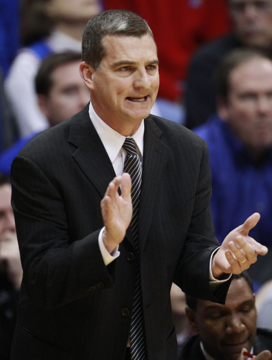 """FILE - In this March 2, 2011, file photo, Texas A&M coach Mark Turgeon urges on his team during an NCAA college basketball game against Kansas in Lawrence, Kan. Turgeon has agreed to take over at Maryland, calling it a """"great opportunity."""" Turgeon went 97-40 in four seasons with the Aggies, leading them to four consecutive appearances in the NCAA tournament. They went 24-9 this past season, losing to Florida State in the second round. (AP Photo/Orlin Wagner, File)"""