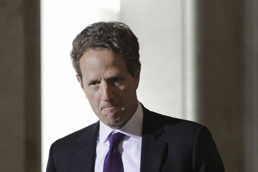 Treasury Secretary Timothy F. Geithner takes his seat after making a statement during the U.S.-China Strategic and Economic Dialogue meetings at the Treasury Department in Washington on Monday, May 9, 2011. (AP Photo/Jacquelyn Martin)