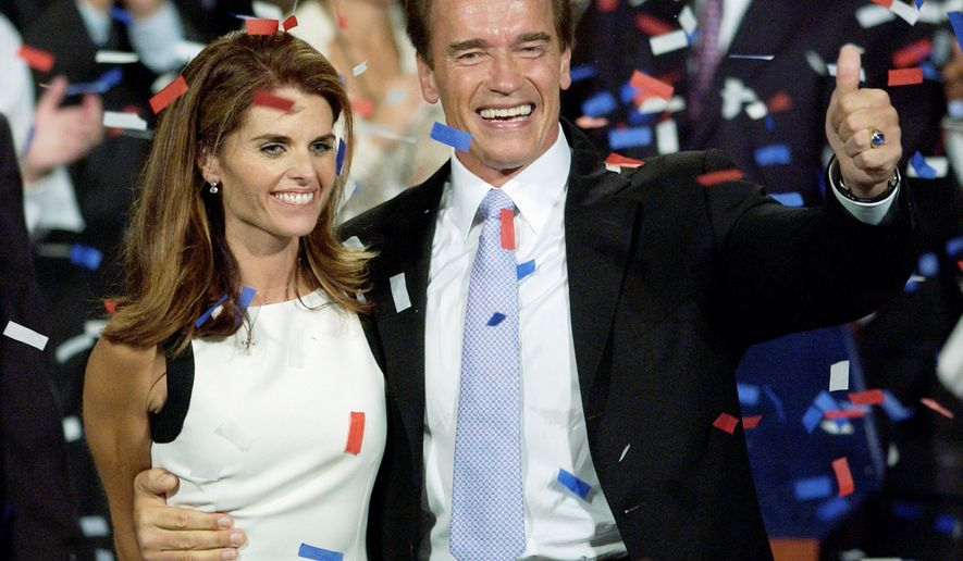 ** FILE ** Arnold Schwarzenegger and wife Maria Shriver celebrate his victory in the California gubernatorial recall election in Los Angeles on Oct. 7, 2003. (AP Photo)