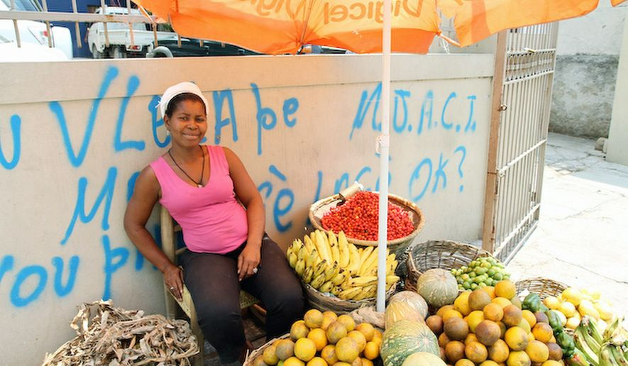 PHOTOGRAPHS BY ERIN WILDERMUTH / SPECIAL TO THE WASHINGTON TIMES Gason Aloude once cleaned houses. Now she sells produce in Petionville, her own business that helps support her husband and five children.