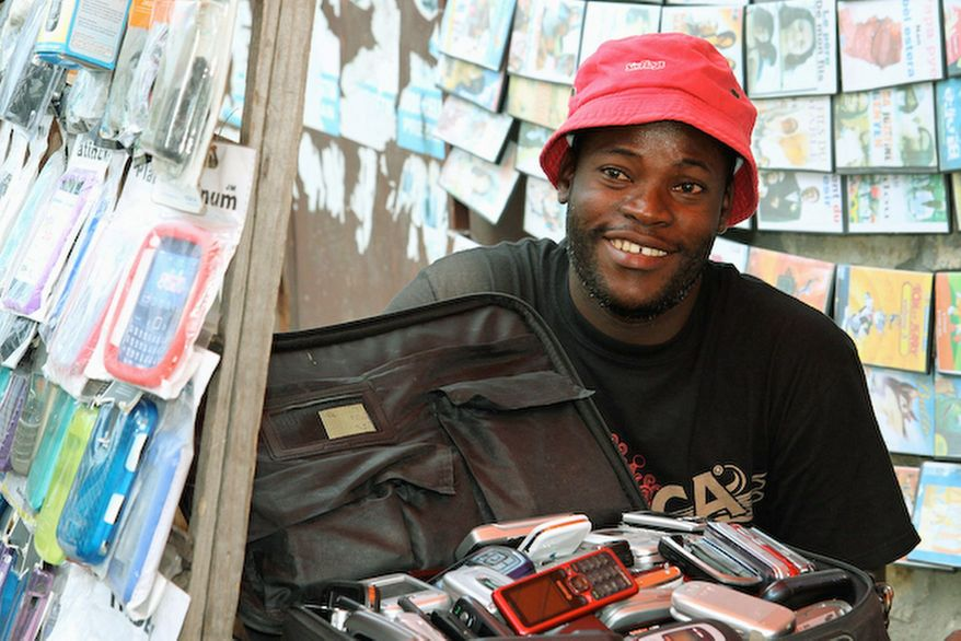 John Colas found his calling fixing cell phones at his street shop on Rue Darguin in Port-au-Prince.
