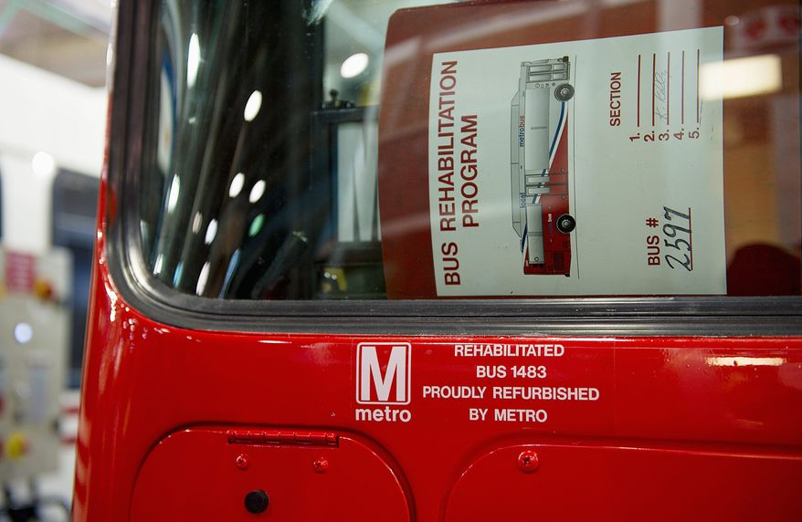 "BARBARA L. SALISBURY/THE WASHINGTON TIMES Each refurbished Metro bus is labeled with a ""Rehabilitated"" note before returning to circulation. Every year, 100 buses are rehabilitated at a cost of $122,000 each during an 8- to 10-week process."