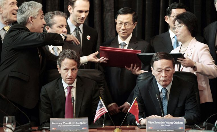 WORKING TOGETHER: Treasury Secretary Timothy F. Geithner and Chinese Vice Premier Wang Qishan wait as documents are exchanged during a signing ceremony on Tuesday in the Cash Room of the Treasury Department in Washington during the U.S.-China Strategic and Economic D