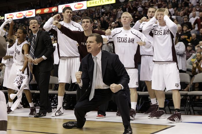 In this Dec. 18, 2010, photo, Texas A&M coach Mark Turgeon and players celebrate during an NCAA college basketball game against Arkansas in Dallas. Turgeon was hired on Monday night, My 9, 2011, by Maryland to succeed Gary Williams, who retired last week after a 22-year run. The 46-year-old Turgeon leaves the Aggies after making four consecutive appearances in the NCAA tournament and going 97-40 in his four-year stay at College Station. (AP Photo/Tony Gutierrez)