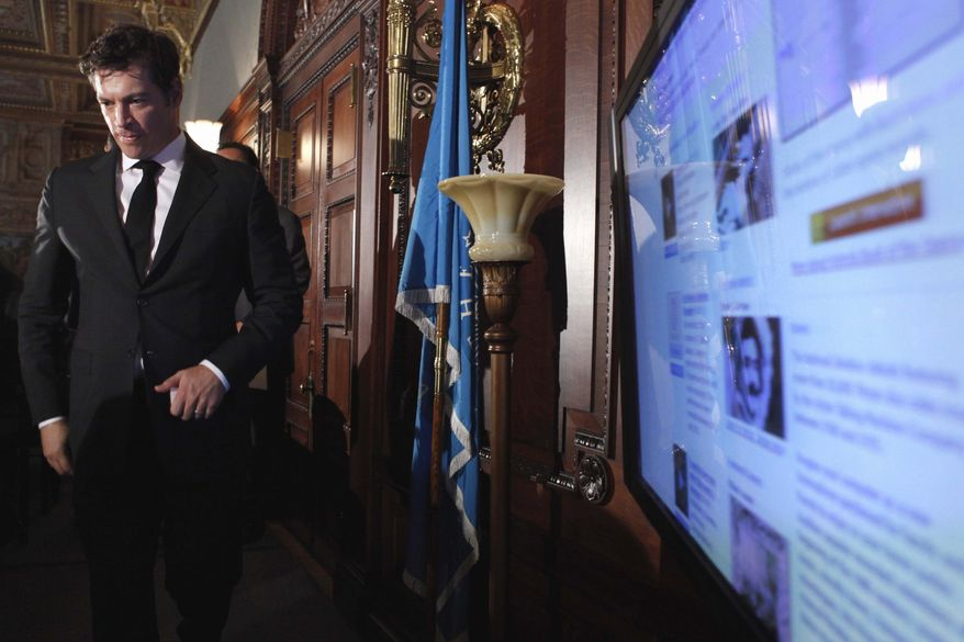 """Musician Harry Connick, Jr. walks past a screen showing the """"National Jukebox,"""" at the Library of Congress, in Washington, Tuesday, May 10, 2011, during a ceremony to introduce the new website, which offers more than 10,000 historic sound recordings for free. (AP Photo/Jacquelyn Martin)"""