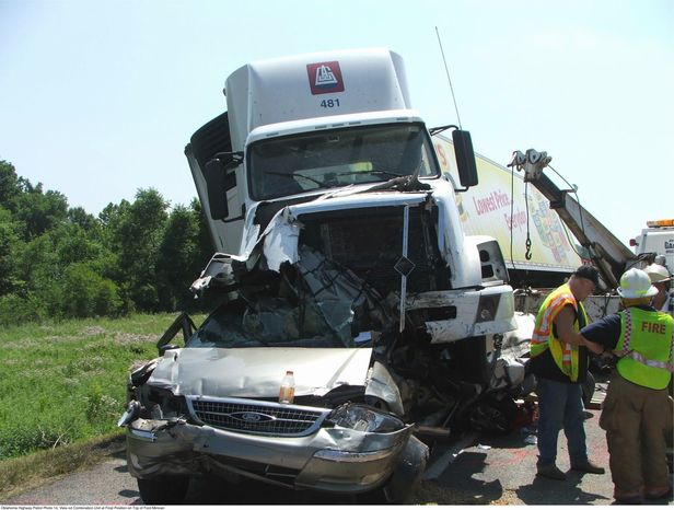 This handout photo provided by the Oklahoma Highway Patrol and the National Transportation Safety Board (NTSB), taken June 26, 2009, shows a tractor-trailer that crashed into cars on Interstate 44 near Miami. Oklahoma. (AP Photo/Oklahoma Highway Patrol, NTSB)