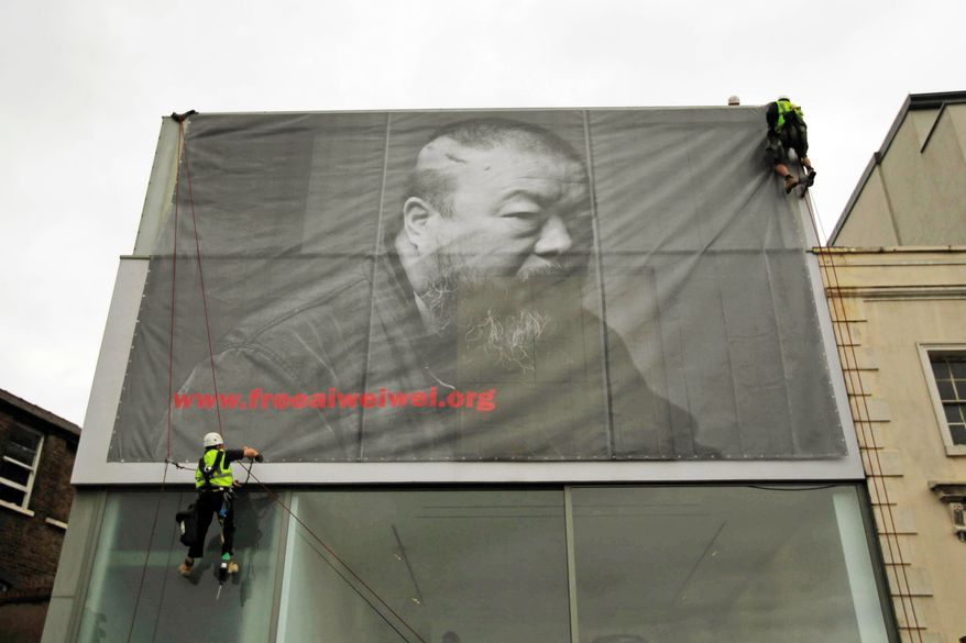A two-story black-and-white photograph of Chinese artist Ai Weiwei is hung outside the Lisson Gallery in London. China's rulers have refused to say where Mr. Ai is after his arrest more than a month ago, prompting a global show of support. (Associated Press)