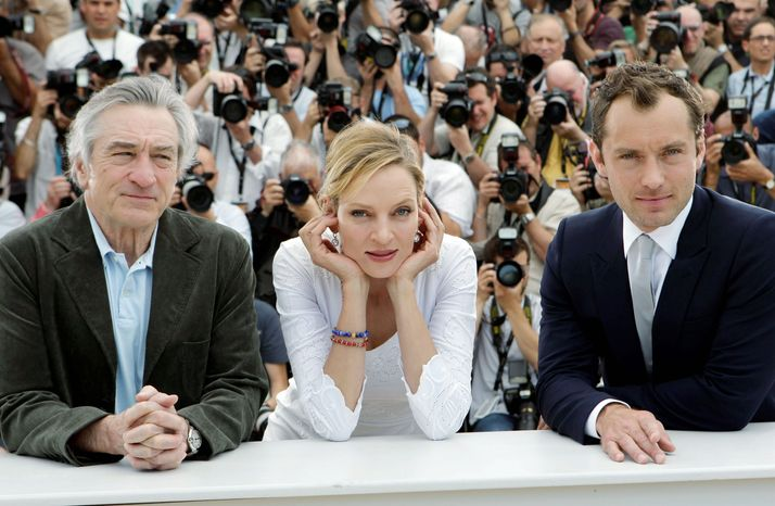 Robert De Niro, Uma Thurman and Jude Law (from left) are part of the nine-member jury that awards prizes among the 20 films in the Cannes main competition. Filmmakers Olivier Assayas a
