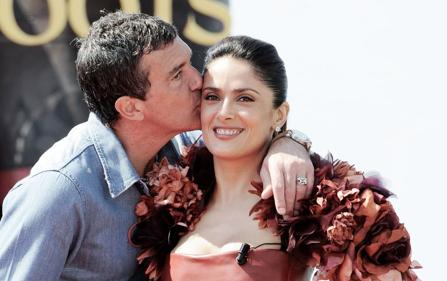 "Antonio Banderas kisses Salma Hayek while promoting ""Puss in Boots."" ""If Salma was beautiful in two dimensions, imagine her in three dimensions,"" Mr. Banderas said while wearing 3-D glasses."
