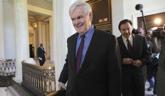 Former House Speaker Newt Gingrich leaves an Hispanic prayer breakfast Wednesday on Capitol Hill. (Associated Press)