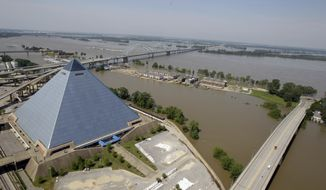 The Pyramid Arena sits protected by a flood wall from the swollen Mississippi River on Tuesday, May 10, 2011, in Memphis, Tenn. The Mississippi crested in Memphis at nearly 48 feet on Tuesday, falling short of its all-time record but still soaking low-lying areas with enough water to require a massive cleanup. (AP Photo/Jeff Roberson)