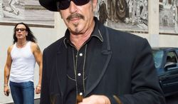 """""""We won't get a helluva lot done in the morning, but we'll work late, and we'll be honest,"""" Kinky Friedman says of musicians as elected officials.  NICOLE WEINGART"""