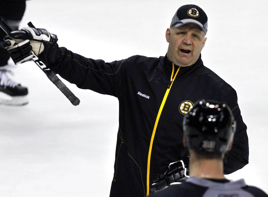 Boston Bruins head coach Claude Julien instructs during practice at TD Garden in Boston Thursday, May 12, 2011 as they prepare for their NHL Stanley Cup Eastern Conference Finals hockey playoff series against the Tampa Bay Lightning which begins Saturday. (AP Photo/Elise Amendola)