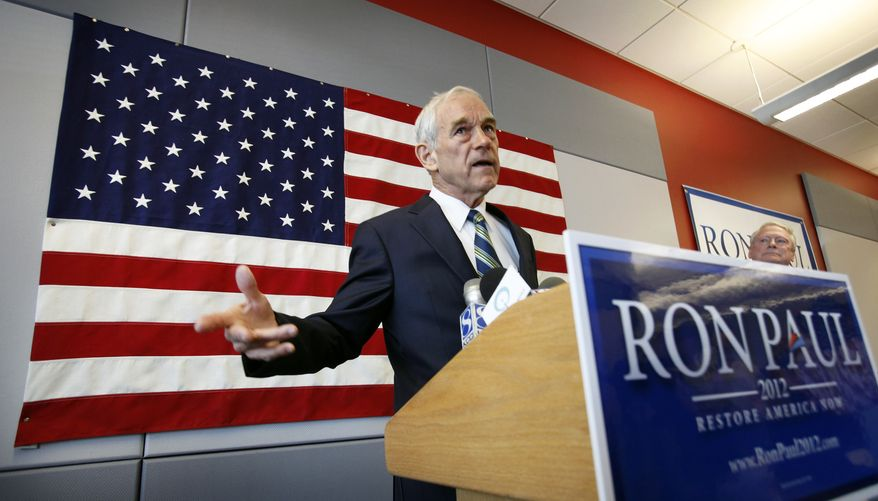 U.S. Rep. Ron Paul, R-Texas, speaks during a news conference at his newly opened Iowa campaign office, Tuesday, May 10, 2011, in Ankeny, Iowa. (AP Photo/Charlie Neibergall)