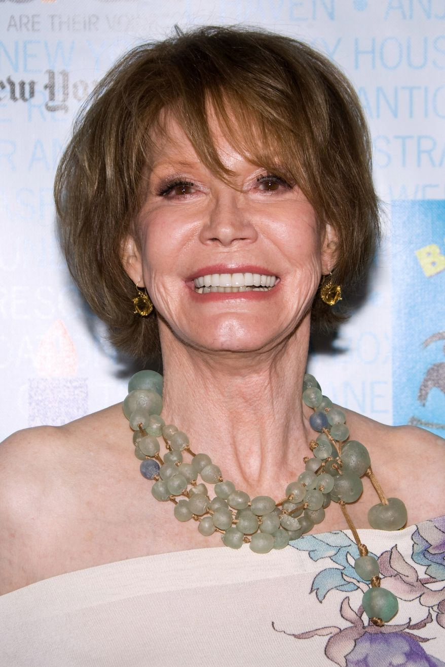 In this July 11, 2009, file photo, actress Mary Tyler Moore attends Broadway Barks 11 in New York. Moore died at the age of 80 on Wednesday, Jan. 25, 2017. (AP Photo/Charles Sykes, file)