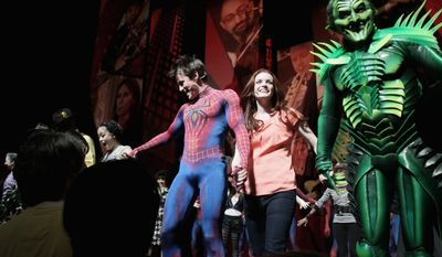 "ASSOCIATED PRESS PHOTOGRAPHS Patrick Page, Jennifer Damiano, Reeve Carney, and T.V. Carpio (from right) react to audience applause during the curtain call for ""Spider-Man: Turn Off The Dark"" following the first preview performance of the revamped show at the Foxwoods Theatre in New York last Thursday."
