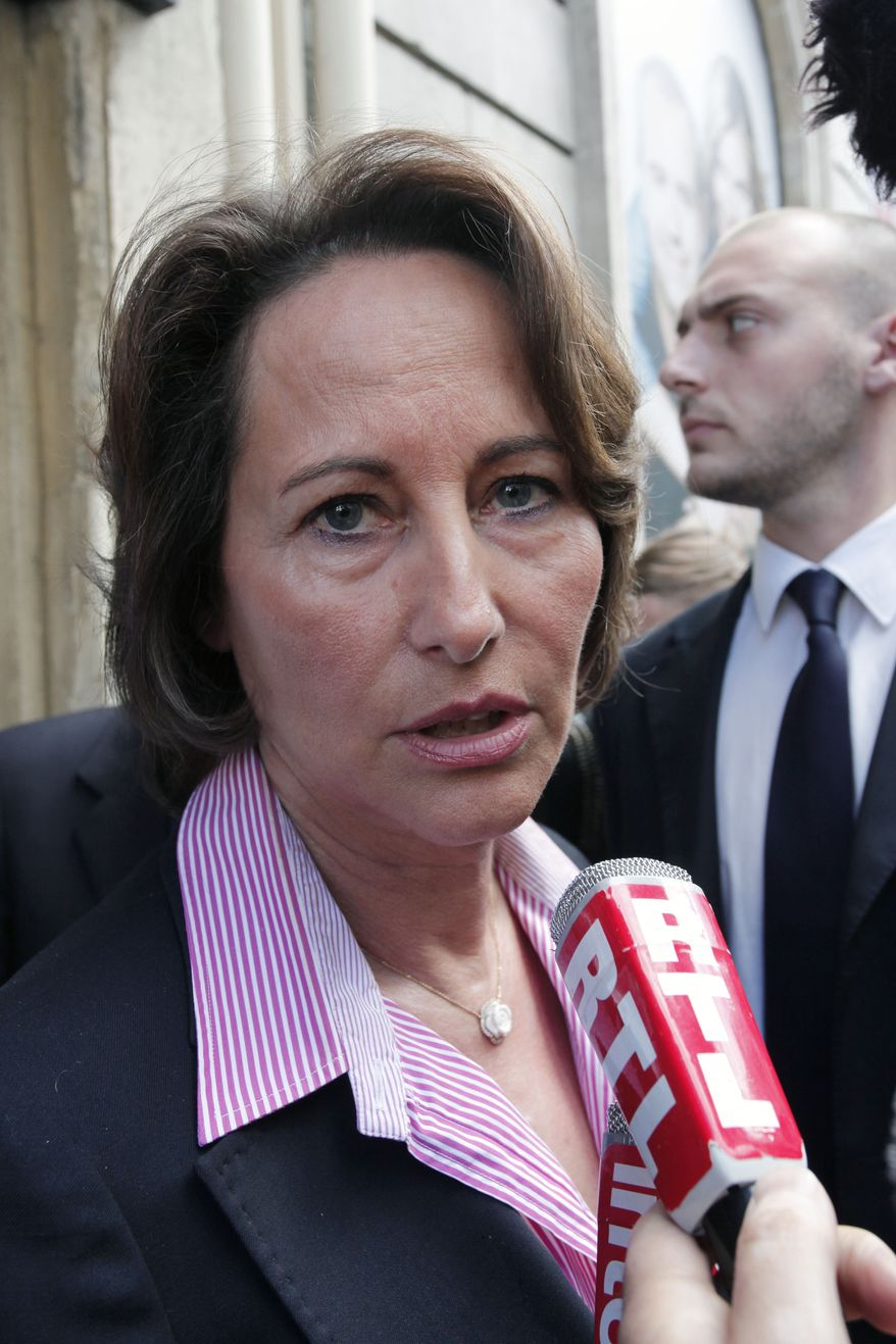 Former French socialist presidential candidate Segolene Royal answers reporters' questions on the arrest of IMF chief Dominique Strauss-Kahn as she leaves the Europe1 radio station in Paris on Sunday, May 15, 2011. (AP Photo/Thibault Camus)