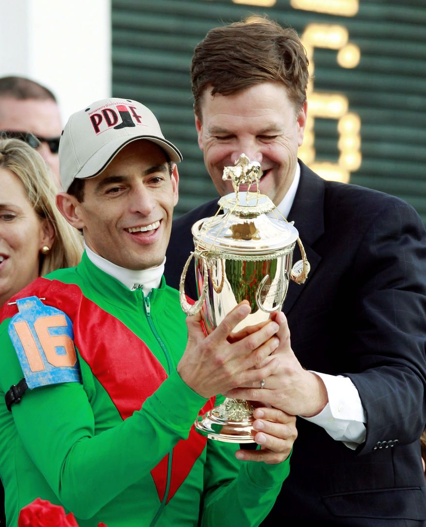 ASSOCIATED PRESS Animal Kingdom trainer Graham Motion (right) celebrated with jockey John Velazquez after winning the Kentucky Derby on May 7. Animal Kingdom will go for his second win of the Triple Crown in the Preakness at Pimlico on Saturday.