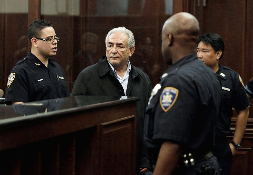 ASSOCIATED PRESS Dominique Strauss-Kahn, head of the International Monetary Fund, waits to be arraigned Monday in Manhattan Criminal Court on charges of rape, sex abuse and other counts after a maid at a Times Square hotel said she was attacked in his penthouse suite.
