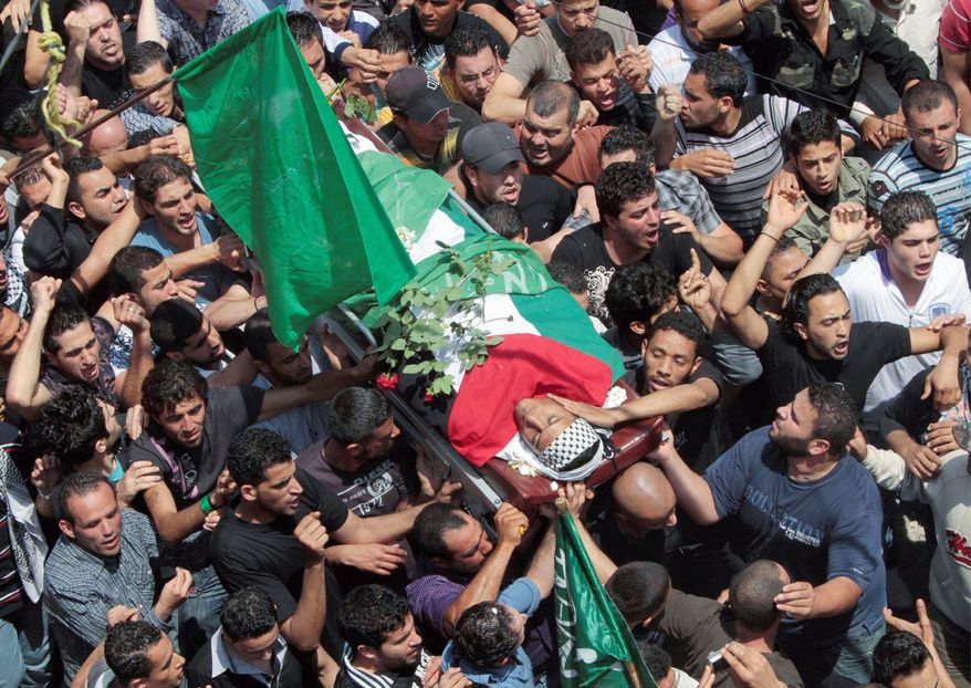 ASSOCIATED PRESS Palestinians in southern Lebanon mourn a man who was killed Sunday when Israeli soldiers opened fire on protesters who approached the Israeli border. Israeli troops clashed with Arab protesters along three hostile borders on Sunday, leaving 15 people dead and dozens wounded.