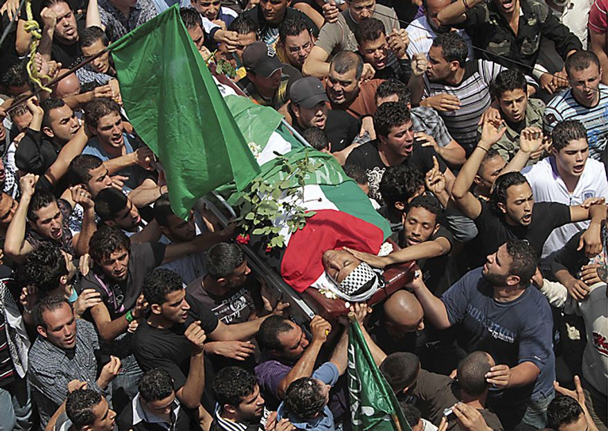 Palestinian mourners carry the body of a Palestinian man who killed when Israeli soldiers opened fire on Sunday at protesters who approached the northen Israeli border with Lebanon, during a funeral procession at Ein el-Hilweh Palestinian refugee camp, in the southern port city of Sidon, southern Le(...)
