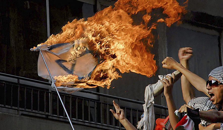 Demonstrators burn an Israeli flag near the Israeli embassy in Cairo, Egypt Sunday, May 15, 2011. Israeli troops clashed with Arab protesters Sunday along three hostile borders, including the frontier with Syria, leaving several people dead and dozens wounded in an unprecedented wave of demonstratio(...)