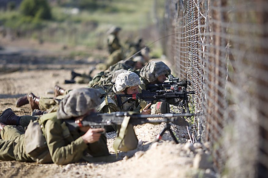 Israeli troops take positions along the border fence between Israel and Syria after Syrian demonstrators marking the anniversary of the mass displacement of Palestinians surrounding Israel's establishment in 1948 approached the village of Majdal Shams in the Golan Height , Sunday, May 15, 2011. Isra(...)