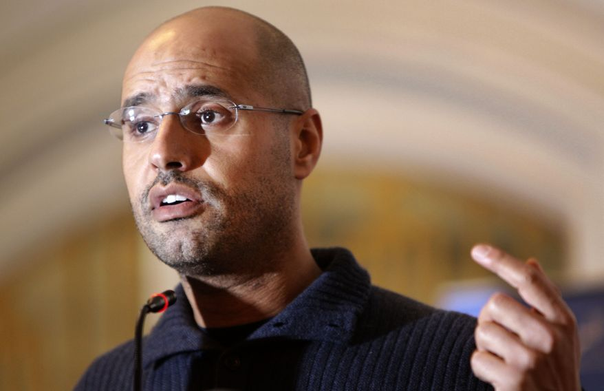 Seif al-Islam Gadhafi, a son of former Libyan leader Col. Moammar Gadhafi's, speaks to the media at a press conference in a hotel in Tripoli, Libya, in February 2011. (Associated Press)