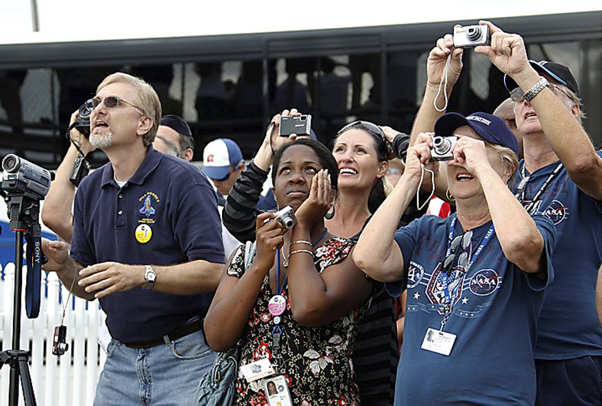 Spectators watch the space shuttle Endeavour lifts off from Kennedy Space Center in Cape Canaveral, Fla., Monday, May 16, 2011. The space shuttle Endeavour began a 14-day mission to the international space station. (AP Photo/Terry Renna)