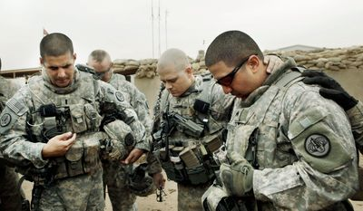 ASSOCIATED PRESS PHOTOGRAPHS Lt. Daniel McCord (left), Staff Sgt. Marc Krugh (center) and Sgt. Christopher Torrentes the 3rd Armored Cavalry Regiment pray before going out on patrol south of Bagdad on Jan. 25. Shiite militias, trying to claim they're driving out U.S. occupiers, have increased attacks.