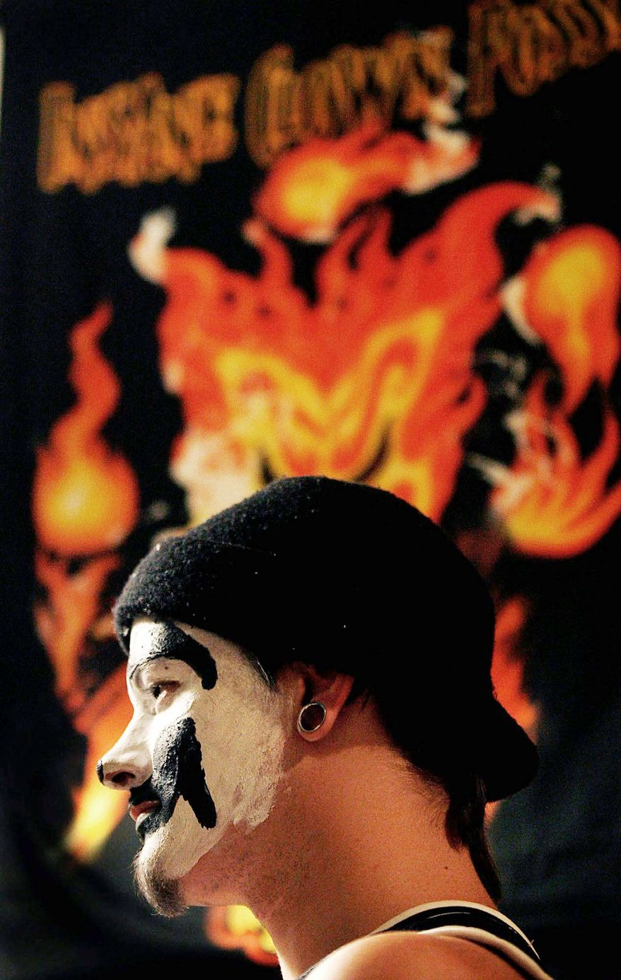 "Fans of Insane Clown Posse are a subculture that's united over love for the music of the underground rap band and the sweet soda Faygo. ""We wanna see all the Juggalos in Heaven,"" said band member Violent J. The band emerged from Detroit in the early '90s, donning clown makeup, mimicking the excesses of pro wrestling, and making no lyrical subject taboo. (Associated Press)"