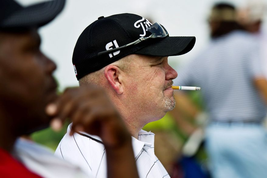 Russell King of La Plata, Md., takes a cigarette break in between holes during the U.S. Open local qualifying tournament. The U.S.. Open runs from June 16-19 at Congressional in Bethesda.