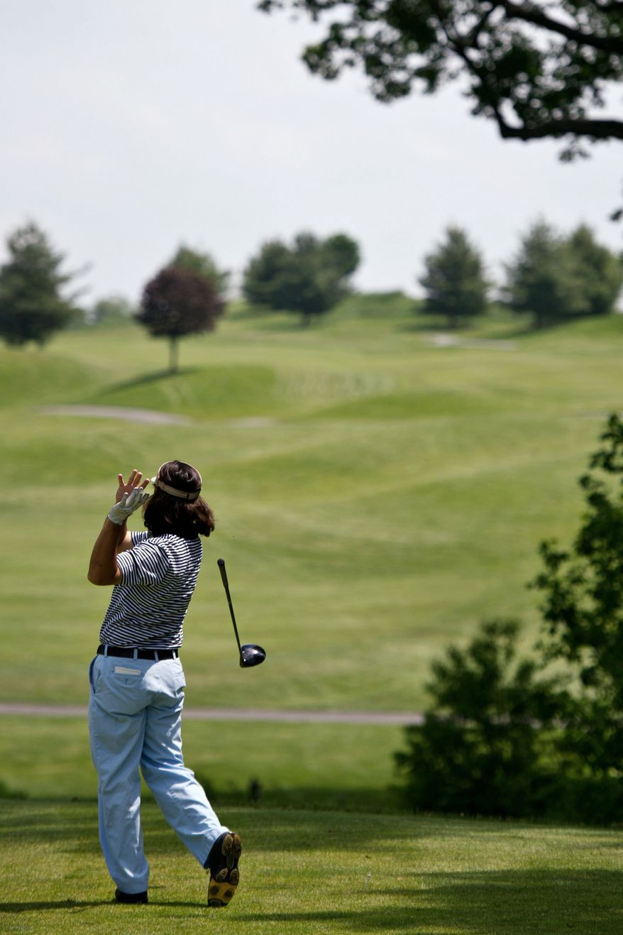 PHOTOGRAPHS BY DREW ANGERER/THE WASHINGTON TIMES Jeff Lim-Sharpe, of La Plata, Md., lets go of his club in frustration after an errant tee shot on the last hole during the U.S. Open local qualifying tournament at Worthington Manor Golf Club, in Urbana, Md.