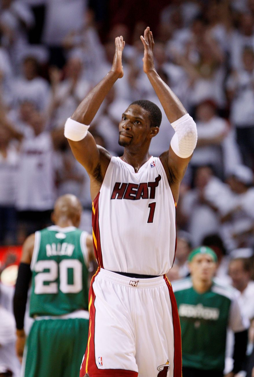 ASSOCIATED PRESS Chris Bosh scored 30 points for Miami in Game 1 against Chicago, but he didn't get much support as the Bulls rolled to a 103-82 win over the Heat.