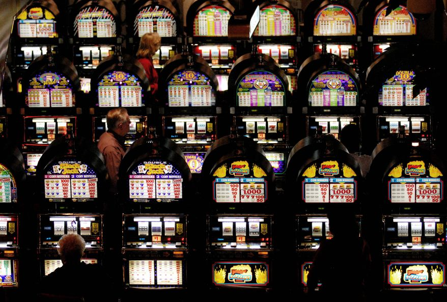THE WASHINGTON TIMES Rows of slot machines line the casino floor at Charles Town Races in West Virginia. Some see a direct connection between the state's approval of slot machines in 1994 and the rejuvenation of the state's breeding industry.