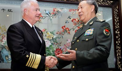 Adm. Timothy Keating, U.S. commander in the Asia-Pacific region, shakes hands with Chinese Gen. Chen Bingde upon arrival at the Ba Yi Building in Beijing in 2008. Gen. Chen, the military chief of staff, arrived in Washington on Monday for the first high-level military exchange since Beijing cut off military ties early last year to protest U.S. arms sales to Taiwan. (Associated Press)