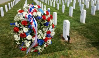 Wreath at graveside of Col. William M. Bower, last of the Doolittle Raid pilots, Arlington National Cemetery, May 16, 2011.